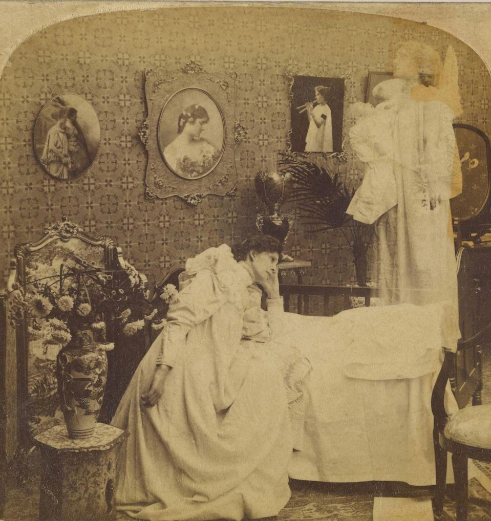 "<p>A woman sits on a bed as a ""ghostly apparition"" floats above a nearby crib. </p>"