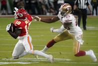 Wide receiver for the Kansas City Chiefs Tyreek Hill (L) carries the ball during Super Bowl LIV between the Kansas City Chiefs and the San Francisco 49ers at Hard Rock Stadium in Miami Gardens, Florida, on February 2, 2020. (Photo by TIMOTHY A. CLARY / AFP) (Photo by TIMOTHY A. CLARY/AFP via Getty Images)