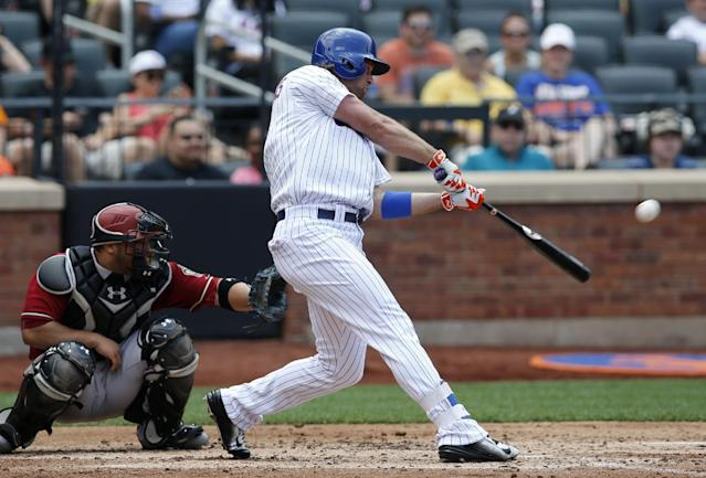New York Mets Kirk Nieuwenhuis (9) hits a third-inning, two-run home run, his second home run of the game, in a baseball game against the Arizona Diamondbacks in New York, Sunday, July 12, 2015. (AP Photo/Kathy Willens)