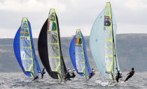 Competitors take part in a practice race in the 49er class during the Weymouth and Portland International Regatta at the Weymouth and Portland National Sailing Academy in southern England August 5, 2011. REUTERS/Eddie Keogh