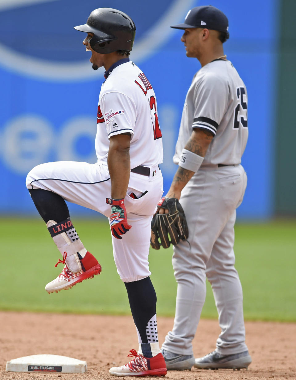 Cleveland Indians' Francisco Lindor celebrates after reaching second base on an error by New York Yankees' Didi Gregorius in the ninth inning of a baseball game, Sunday, June 9, 2019, in Cleveland. Jose Ramirez would score. The Yankees won 7-6. (AP Photo/David Dermer)