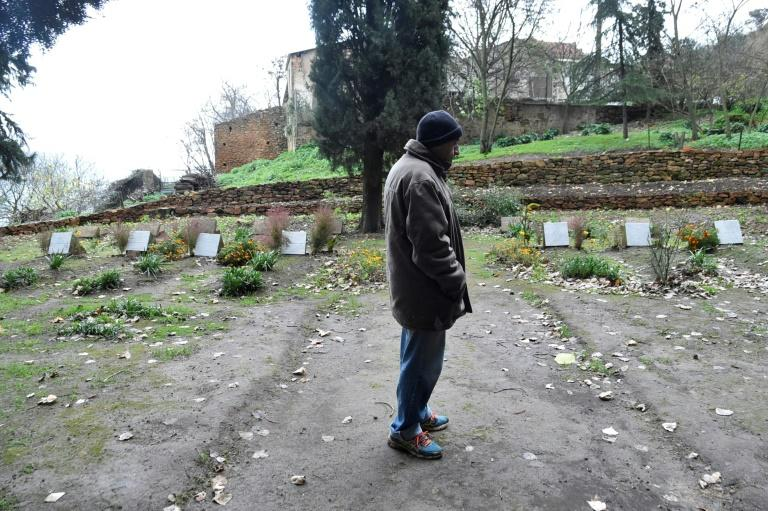 Brother Bruno stands near the graves of seven French Trappist monks at the Tibhirine monastery