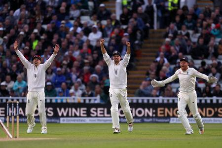 Cricket - England vs West Indies - First Test - Birmingham, Britain - August 19, 2017   England's Joe Root, Alastair Cook and Jonny Bairstow celebrate the wicket of West Indies' Roston Chase   Action Images via Reuters/Paul Childs