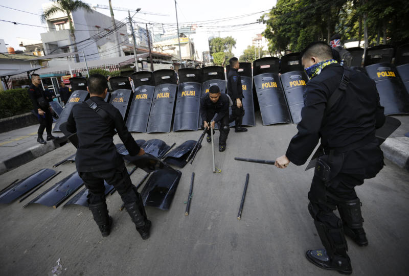 Police officers arrange their riot gears a day after the clash with supporters of Indonesian presidential candidate Prabowo Subianto in Jakarta, Indonesia, Thursday, May 23, 2019. The defeated candidate in Indonesia's presidential election is expected to challenge the result in court Thursday as calm returned to the capital following a 24-hour spasm of apparently orchestrated violence. (AP Photo/Dita Alangkara)