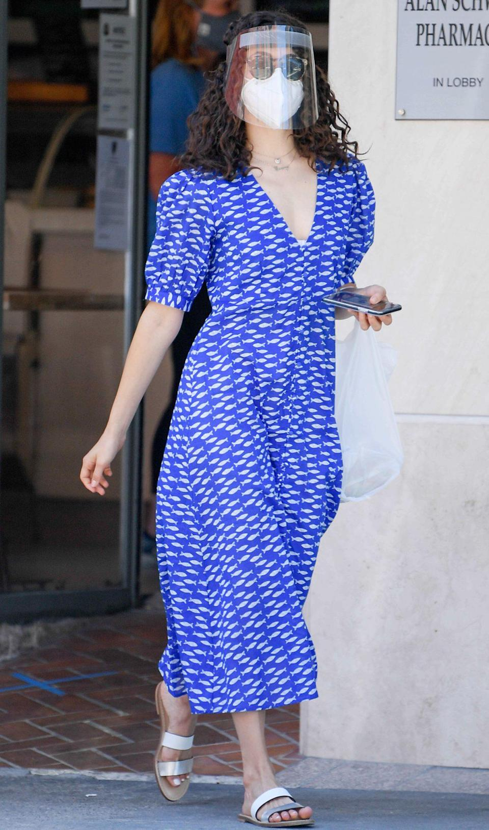 <p>Emmy Rossum picks up lunch from Nate 'n Al's Deli in Beverly Hills on Wednesday dressed in a summery blue sundress and strappy sandals.</p>