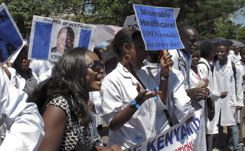 FILE In this file photo of Monday, June 13, 2011 striking Kenyan doctors march through Nairobi, Kenya. Doctors in Kenya's public hospitals on Wednesday spent their 17th day on strike to protest the dilapidated state of public health care. Emergency rooms in some of Kenya's public hospitals frequently don't have gloves or medicine, and power outages sometimes force doctors to use the light from their phones to complete a procedure. Kenya's government fired 1,000 of the 2,000 striking doctors last week despite a shortfall of skilled medical practitioners.(AP Photo/Katharine Houreld-file)