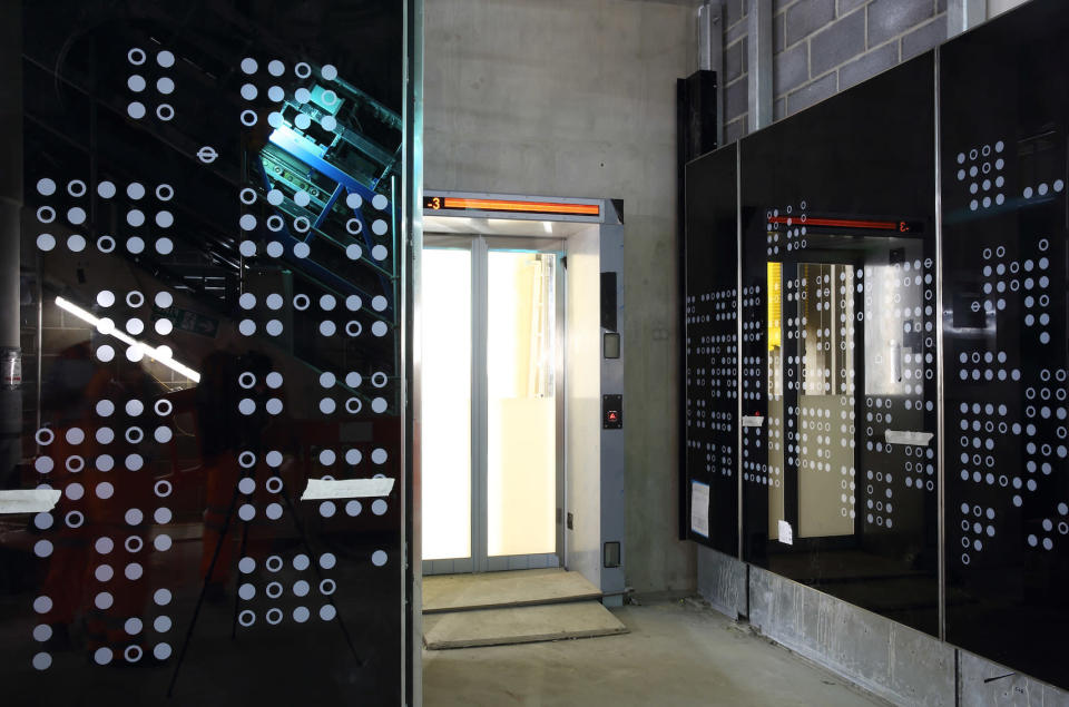 <p>Glass panels with Soho street map decorations go up in Tottenham Court Road. </p>