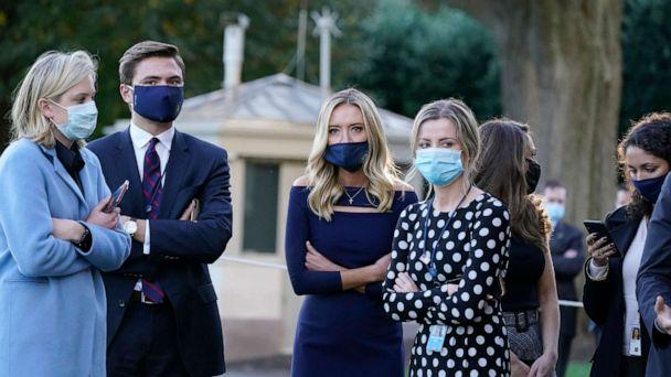 PHOTO: White House press secretary Kayleigh McEnany, third from left, waits with others as President Donald Trump prepares to leave the White House to go to Walter Reed National Military Medical Center after he tested positive for COVID-19, Oct. 2, 2020. (Alex Brandon/AP)