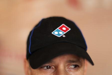 Australia's Domino's Pizza sued for underpaying staff, shares slide