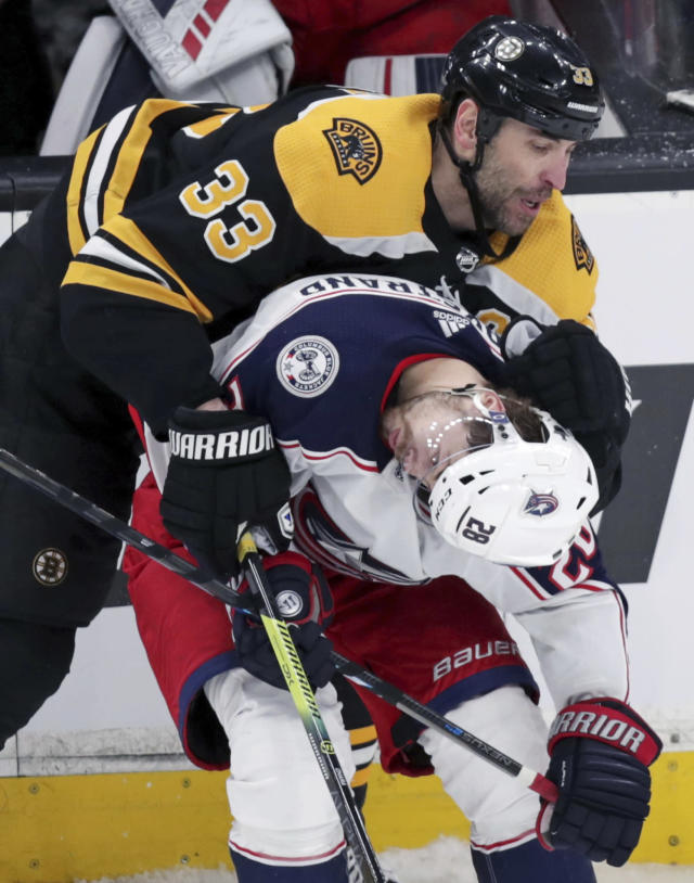 Boston Bruins defenseman Zdeno Chara (33) bends Columbus Blue Jackets right wing Oliver Bjorkstrand's head over as they chase the puck during the third period of Game 1 of an NHL hockey second-round playoff series, Thursday, April 25, 2019, in Boston. (AP Photo/Charles Krupa)