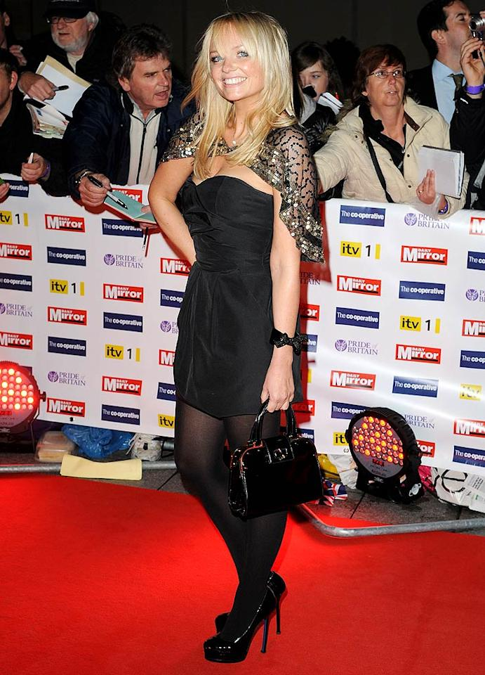 """Across the pond in London, Spice Girl Emma Bunton showed off her perky personality upon arriving at the Pride of Britain Awards by pairing a sassy gold cape with her LBD. James Whatling/<a href=""""http://www.splashnewsonline.com"""" target=""""new"""">Splash News</a> - October 5, 2009"""