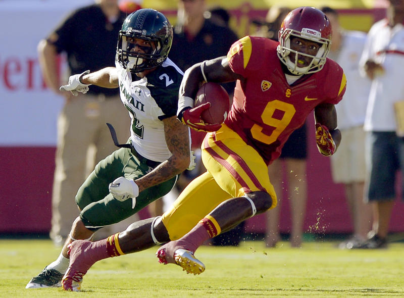 Southern Californa wide receiver Marqise Lee, right, runs the ball as Hawaii defensive back Tony Grimes defends during the first half of their NCAA college football game, Saturday, Sept. 1, 2012, in Los Angeles. (AP Photo/Mark J. Terrill)