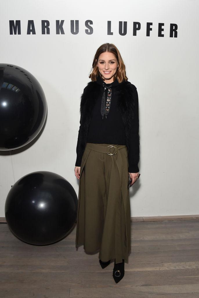 <p>Olivia Palermo donned a neck-tie (one of the biggest trends spotted on the runway this season) with a khaki midi. <em>[Photo: Getty]</em> </p>