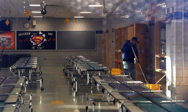 PHOTO: A man cleans the cafeteria of P.S. 156 and L.S. 392, as the New York City school system canceled classes after further cases of coronavirus were confirmed in New York, March 16, 2020. (Shannon Stapleton/Reuters)