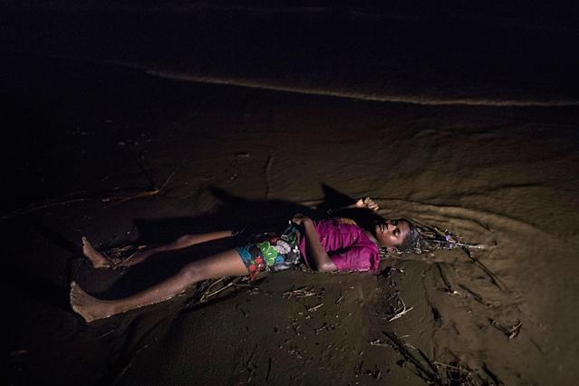 <p>The body of a Rohingya woman lays on a beach washed up after a boat sunk in rough seas off the coast of Bangladesh carrying over 100 people on September 28 close to Patuwartek, Inani beach, Bangladesh. Seventeen survivors were found along with the bodies of 15 women and children. Over 500 Rohingya refugees have fled into Bangladesh since late August during the outbreak of violence in Rakhine state as Myanmar's de facto leader Aung San Suu Kyi downplayed the crisis during a speech in Myanmar this week faces and defended the security forces while criticism of her handling of the Rohingya crisis grows. Bangladesh's prime minister, Sheikh Hasina, spoke at the United Nations General Assembly last week, focusing on the humanitarian challenges of hosting the minority Muslim group who currently lack food, medical services, and toilets, while new satellite images from Myanmar's Rakhine state continue to show smoke rising from Rohingya villages. (Photograph by Paula Bronstein/Getty Images) </p>