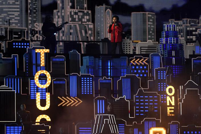 The Weeknd performs during halftime of the NFL Super Bowl 55 football game between during the halftime show of the NFL Super Bowl 55 football game between the Kansas City Chiefs and Tampa Bay Buccaneers, Sunday, Feb. 7, 2021, in Tampa, Fla. (AP Photo/Ashley Landis)