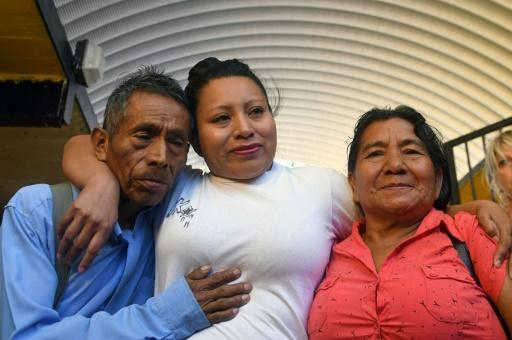 In this file photo taken on February 15, 2018, Teodora Vasquez hugs her parents shortly after being released from the women's Readaptation Center in Ilopango, El Salvador, where she had been jailed for 10 years