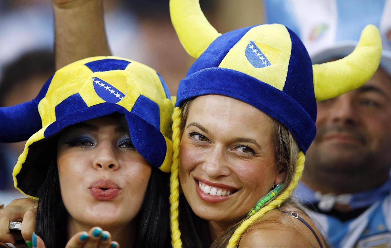 Fans pose before the start of the group F World Cup soccer match between Argentina and Bosnia at the Maracana Stadium in Rio de Janeiro, Brazil, Sunday, June 15, 2014.  (AP Photo/Kirsty Wigglesworth)