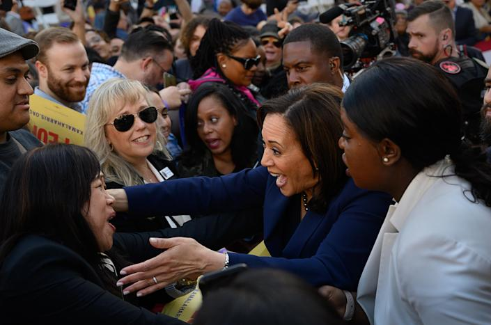 """<span class=""""s1"""">Kamala Harris greets a supporter as she launches her 2020 campaign in Oakland, Calif., on Sunday. (Photo: Paul Kitagaki Jr./ZUMA Wire)</span>"""