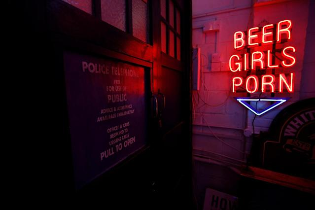 <p>A neon sign that reads 'Beer, Girls, Porn' is reflected in an old Police Box in God's Own Junkyard gallery and cafe in London, Britain, May 13, 2017. (Photo: Russell Boyce/Reuters) </p>