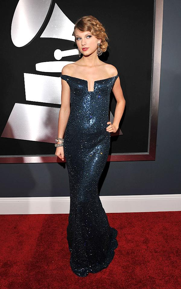 """Taylor Swift  Grade: A-   The Album of the Year winner put her recent red carpet failures to rest in a fabulous sapphire, off-the-shoulder Kaufman Franco gown, chandelier earrings, and sideswept 'do. Lester Cohen/<a href=""""http://www.wireimage.com"""" target=""""new"""">WireImage.com</a> - January 31, 2010"""