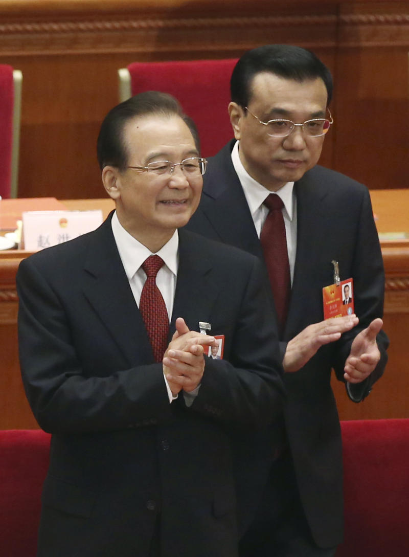 China's newly appointed Premier Li Kiqiang, right, and former Chinese Premier Wen Jiabao applaud at the closing session of the National People's Congress at the Great Hall of the People in Beijing China, Sunday, March 17, 2013.  China's new leader Xi Jinping pledged a cleaner, more efficient government Sunday as the country's ceremonial legislature wrapped up a pivotal session that installed the latest generation of communist leaders in a once-a-decade transfer of power.(AP Photo/Kin Cheung)