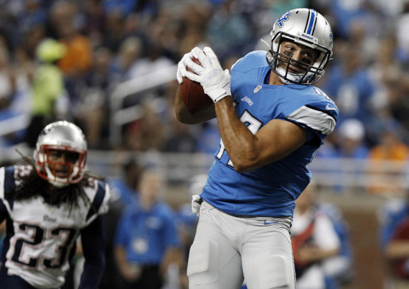 Detroit Lions tight end Joseph Fauria (47) catches a 22-yard touchdown pass as New England Patriots defensive back Marquice Cole (23) defends in the third quarter of an NFL preseason football game in Detroit, Thursday, Aug. 22, 2013. (AP Photo/Duane Burleson)