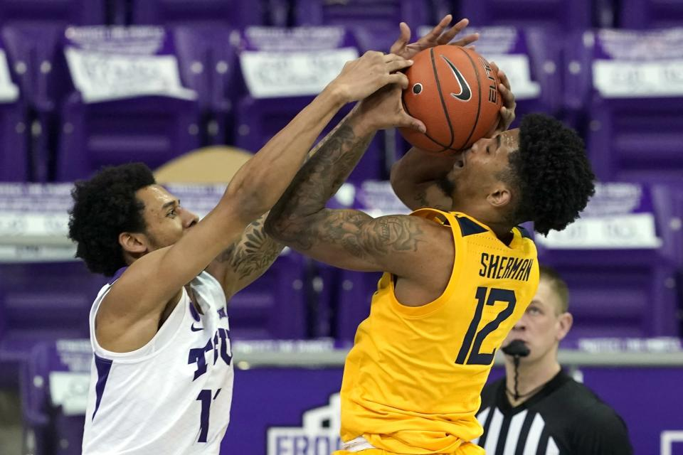 TCU guard Taryn Todd (11) fouls West Virginia's Taz Sherman (12) on a shot attempt in the second half of an NCAA college basketball game in Fort Worth, Texas, Tuesday, Feb. 23, 2021. (AP Photo/Tony Gutierrez)