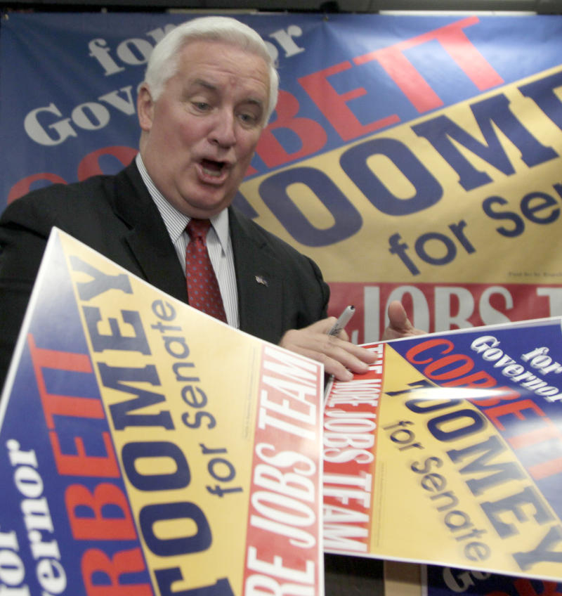 Pennsylvania Republican gubernatorial candidate Tom Corbett is surrounded by campaign signs waiting for his autograph after a rally in Camp Hill, Pa., Monday, Nov. 1, 2010. (AP Photo/Carolyn Kaster)