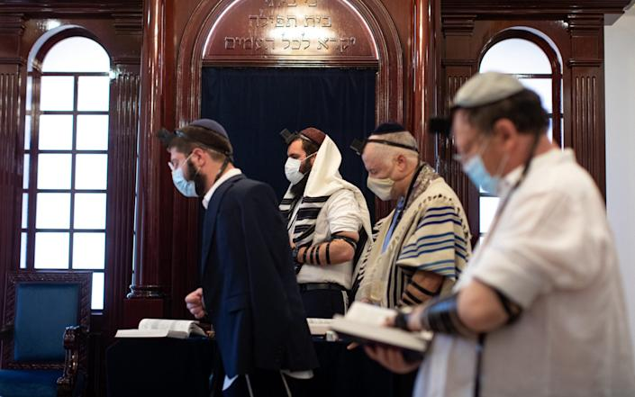 Rabbi Levi Duchman, centre, and members of the congregation pray ahead of Rosh Hashanah, the Jewish New Year, at the only known synagogue in the Arabian Peninsula - Christopher Pike