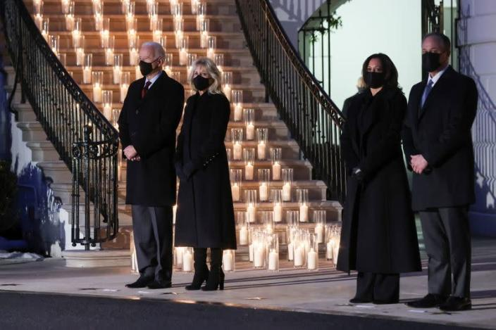 U.S. President Joe Biden commemorates the grim milestone of 500,000 U.S. deaths from the coronavirus disease (COVID-19) during a moment of silence and candle lighting ceremony at the White House in Washington