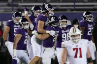 Northwestern players celebrate after they defeated Wisconsin 17-7 in an NCAA college football game in Evanston, Ill., Saturday, Nov. 21, 2020. (AP Photo/Nam Y. Huh)