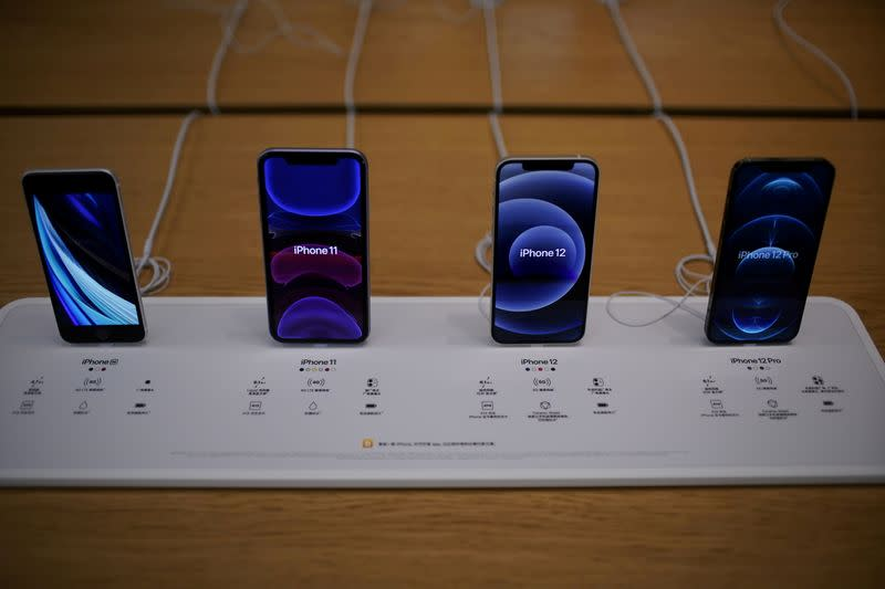 FILE PHOTO: Apple's 5G iPhone 12 and iPhone 11 are seen at an Apple Store in Shanghai