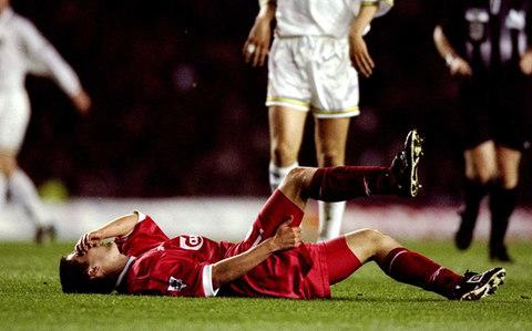 Michael Owen clutches his hamstring in pain - Credit: Getty Images