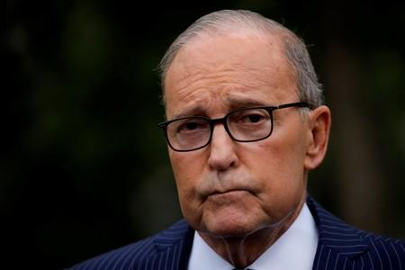 FILE PHOTO: White House chief economic adviser Larry Kudlow talks with reporters on the driveway outside the West Wing of the White House in Washington, U.S.