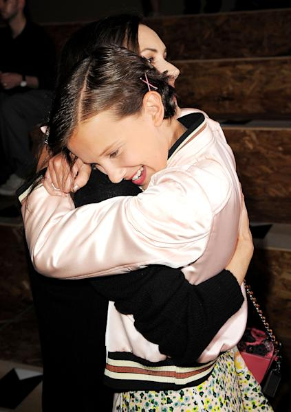 Winona Ryder and her young costar Millie Bobby Brown (a.k.a. Eleven) had the sweetest 'Stranger Things' reunion at New York Fashion Week 2016 on September 13 at Coach — see the pics!
