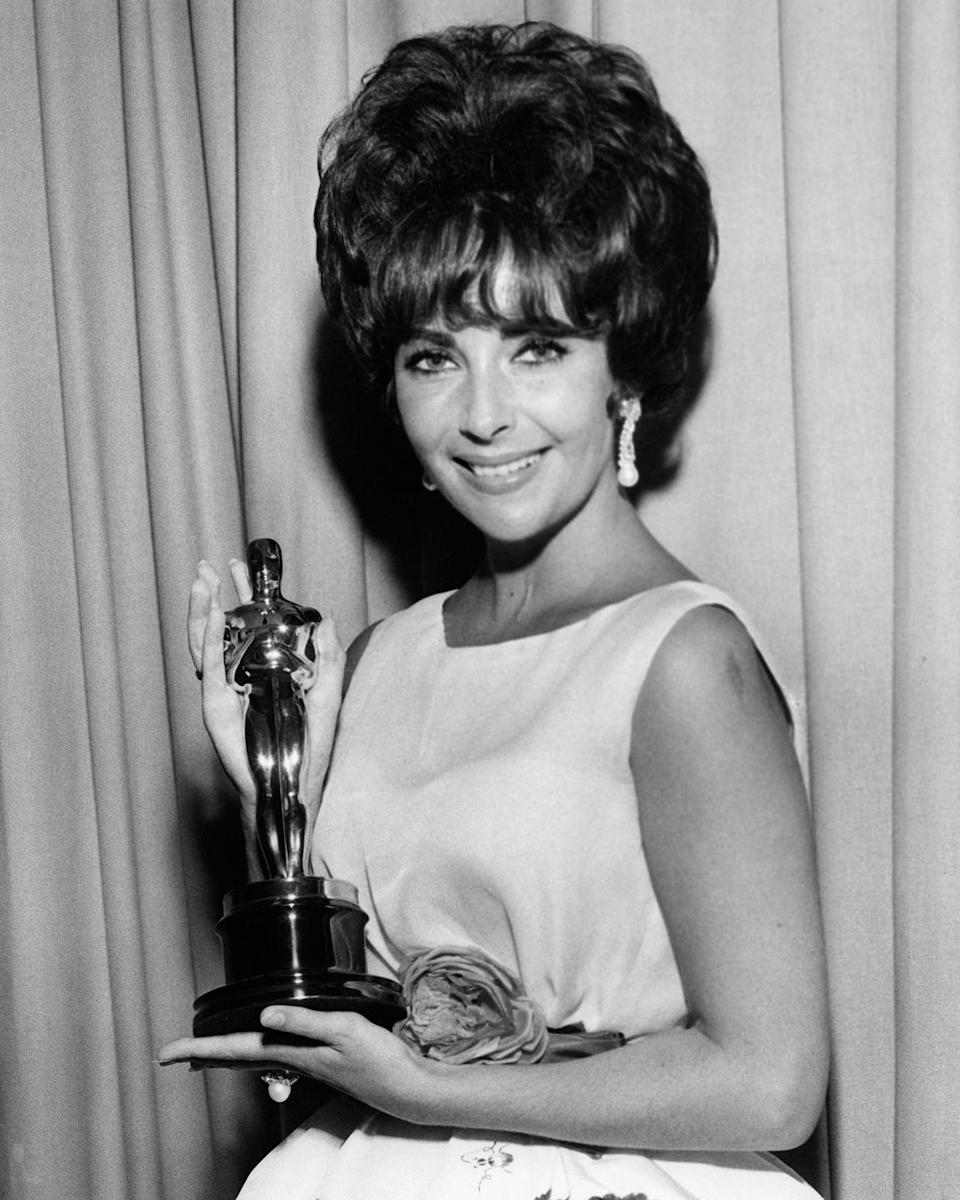 """<p>When <a href=""""http://www.slate.com/articles/podcasts/you_must_remember_this/2015/12/elizabeth_taylor_and_eddie_fisher_s_affair_and_taylor_s_oscar.html"""" rel=""""nofollow noopener"""" target=""""_blank"""" data-ylk=""""slk:Elizabeth Taylor received her award"""" class=""""link rapid-noclick-resp"""">Elizabeth Taylor received her award</a>, it was on the heels of her affair with Eddie Fisher, who was married to Debbie Reynolds —<span class=""""redactor-invisible-space""""> basically America's sweetheart. This caused many people to see Taylor unfavorably. As if that wasn't enough, she won for her role in <a href=""""https://en.wikipedia.org/wiki/BUtterfield_8"""" rel=""""nofollow noopener"""" target=""""_blank"""" data-ylk=""""slk:Butterfield 8"""" class=""""link rapid-noclick-resp""""><em>Butterfield 8</em></a>, where she plays (as her character calls herself) the """"slut of all time."""" Needless to say, more than a few eyebrows were raised when she won. </span></p><p><span class=""""redactor-invisible-space""""><strong>RELATED:</strong> <a href=""""https://www.goodhousekeeping.com/beauty/fashion/g4436/history-naked-dresses/"""" rel=""""nofollow noopener"""" target=""""_blank"""" data-ylk=""""slk:The Most Scandalous Red Carpet Dresses Ever"""" class=""""link rapid-noclick-resp"""">The Most Scandalous Red Carpet Dresses Ever</a><br></span></p>"""