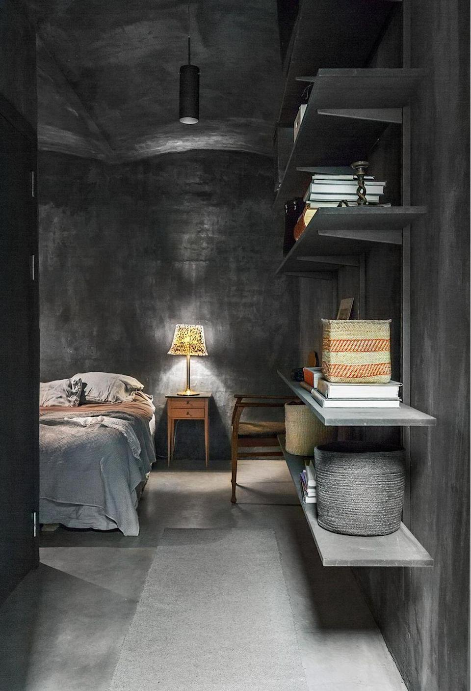 <p>There are plenty of ways to texture your paint without going hi-shine gloss. Instead, try this edgy matte vibe with a cement effect paint. Polished concrete is both subtle and bold, especially if you choose a darker tone, like this one. </p>