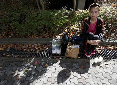 Haruka Rong, a former Cambodian refugee who came to Japan 30 years ago, rests after having lunch with her family during Asia Sports Festa in Yokohama, south of Tokyo, Japan, October 25, 2015. REUTERS/Yuya Shino/Files