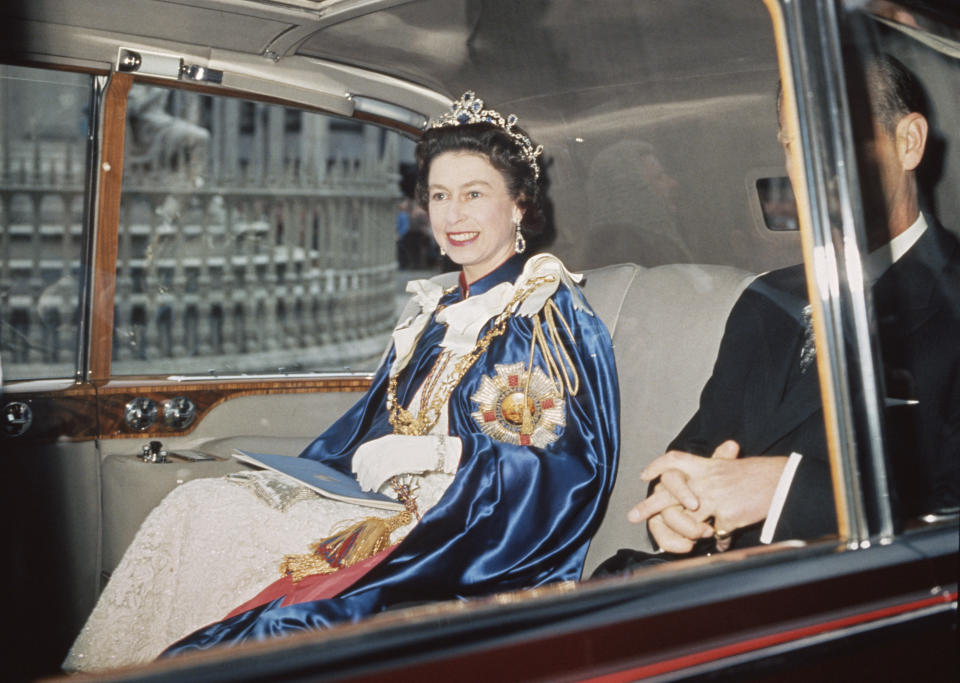 Queen Elizabeth II and Prince Philip attend a service for the Order of St Michael and St George at St Paul's Cathedral, London, 24th July 1968. The Queen is wearing the Star of the Order, which bears the motto 'Auspicium Melioris Aevi'.  (Photo by Hulton Archive/Getty Images)