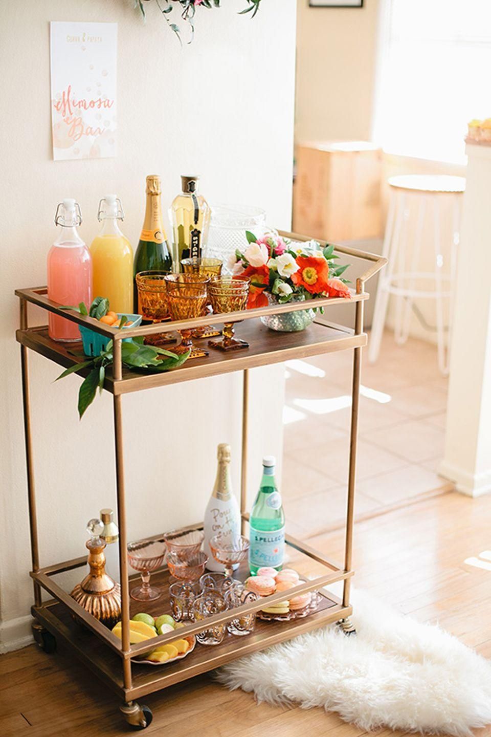"""<p>Every perfectly curated mimosa bar needs stunning glassware guests can fill up. Champagne flutes or coupes are solid choices, but you can always go with anything from tumblers to the nice glass set in your cabinet you've been dying to break out.</p><p>See more at <a href=""""http://www.100layercake.com/blog/2015/04/01/easter-brunch-inspiration-spring-party-ideas/"""" rel=""""nofollow noopener"""" target=""""_blank"""" data-ylk=""""slk:100 Layers of Cake"""" class=""""link rapid-noclick-resp"""">100 Layers of Cake</a>.<br></p>"""