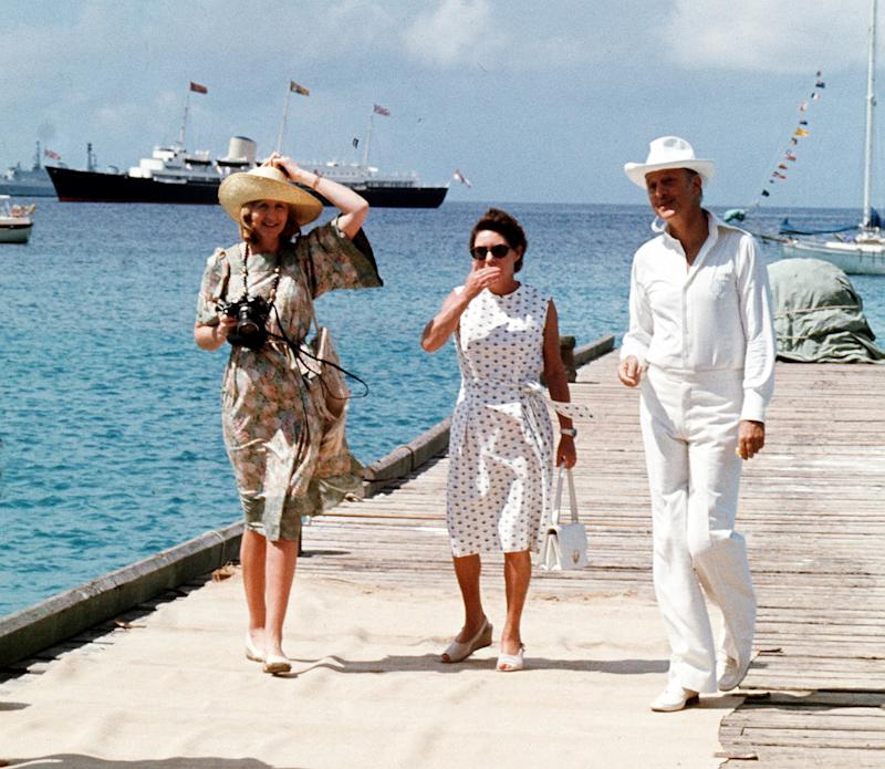 Mustique is a favourite with Princess Margaret (centre), pictured here in 1977 with friends Lady Ann Tennant and Colin Tennant waiting on the jetty on the Caribbean island of Mustique to greet the Queen (Picture: PA)