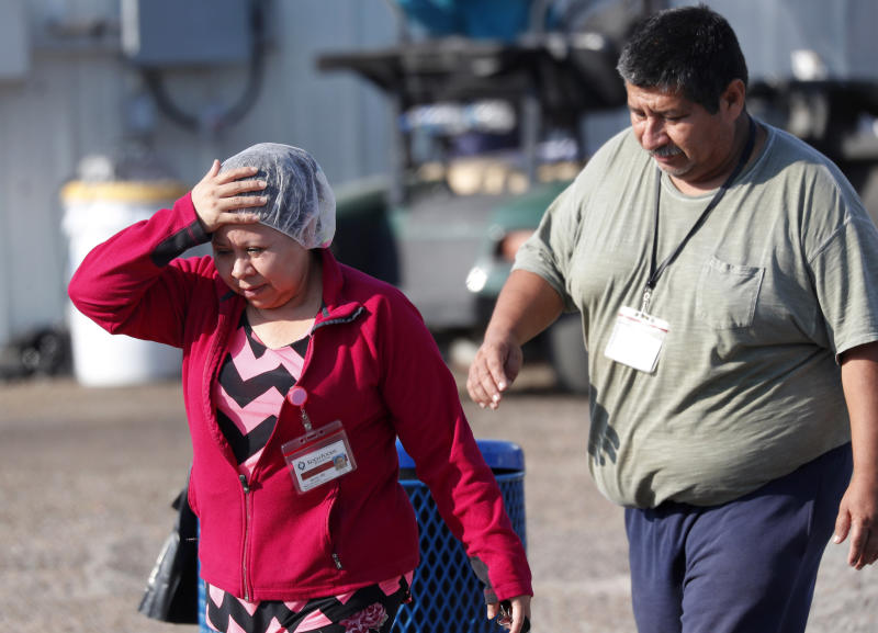 Koch Foods Inc., employees leave the Morton, Miss., plant following a raid by U.S. immigration officials in Morton, Miss., Wednesday, Aug. 7, 2019. U.S. immigration officials raided several Mississippi food processing plants on Wednesday and signaled that the early-morning strikes were part of a large-scale operation targeting owners as well as employees. (AP Photo/Rogelio V. Solis)
