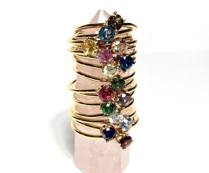 "<h2>Gold-Plated Birthstone Ring</h2><br>Add an accent to each finger with a gleaming birthstone ring — crafted in pretty, dainty silhouettes ideal for stacking. <br><br><em>Shop <a href=""https://www.etsy.com/shop/AnneSwainjewelry"" rel=""nofollow noopener"" target=""_blank"" data-ylk=""slk:Anne Swain Jewelry"" class=""link rapid-noclick-resp""><strong>Anne Swain Jewelry</strong></a></em><br><br><strong>AnneSwainjewelry</strong> Gold-Plated Birthstone Ring, $, available at <a href=""https://go.skimresources.com/?id=30283X879131&url=https%3A%2F%2Ffave.co%2F2JcKBgg"" rel=""nofollow noopener"" target=""_blank"" data-ylk=""slk:Etsy"" class=""link rapid-noclick-resp"">Etsy</a>"