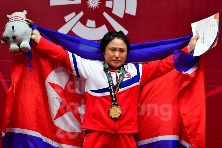 North Korea's Ri Song Gum tried twice to attempt an Asian Games record and personal best of 117kg but departed in agony as her left knee buckled