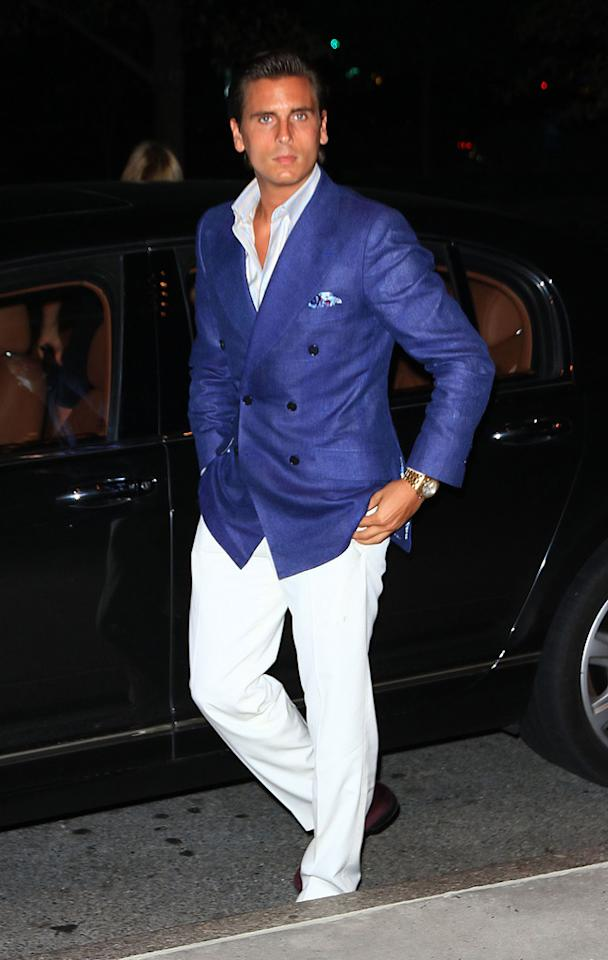 "How could Kourtney Kardashian be attracted to a man (baby daddy Scott Disick) that insists upon dressing like tanzilla George Hamilton? Jackson Lee/<a href=""http://www.splashnewsonline.com"" target=""new"">Splash News</a> - July 27, 2010"