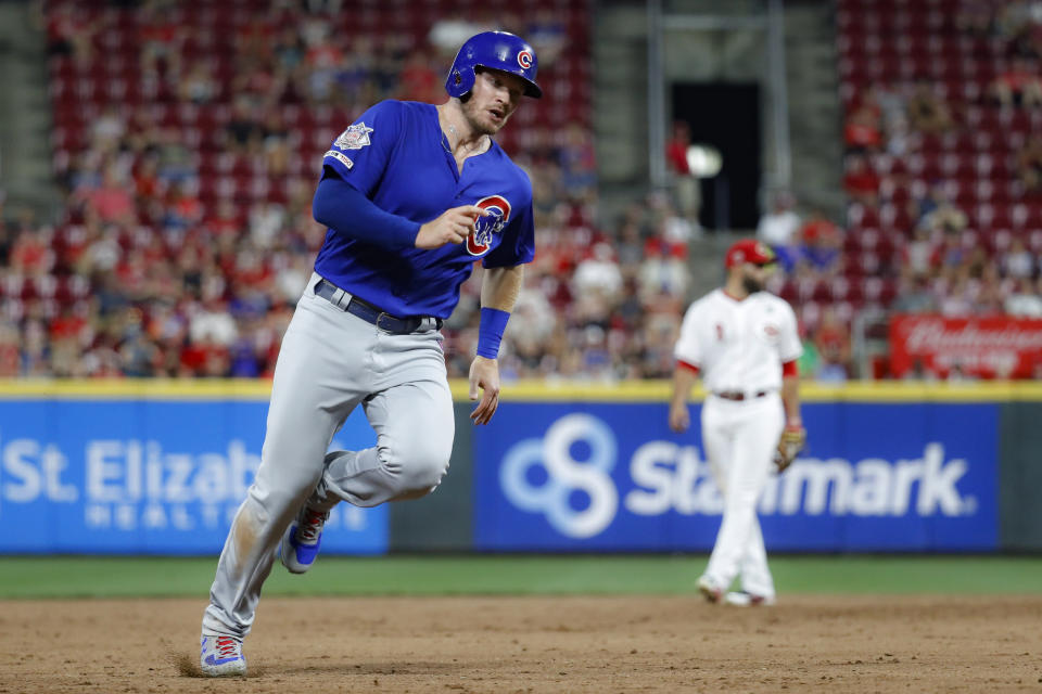 Chicago Cubs' Ian Happ runs home to score on a double by Jonathan Lucroy during the fifth inning of a baseball game against the Cincinnati Reds on Thursday, Aug. 8, 2019, in Cincinnati. (AP Photo/John Minchillo)