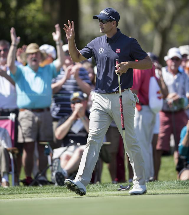 Adam Scott waves to the crowd after he birdied the seventh hole during the first round of the Arnold Palmer Invitational golf tournament at Bay Hill Thursday March 20, 2014, in Orlando, Fla. (AP Photo/Willie J. Allen Jr.)