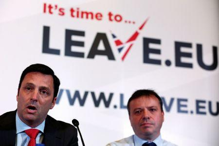 FILE PHOTO: Gerry Gunster (L), a Washington-based strategist hired by the Leave.EU campaign, speaks as he sits with Arron Banks, a British businessman, during a Leave.EU news conference in central London, Britain November 18, 2015. REUTERS/Stefan Wermuth
