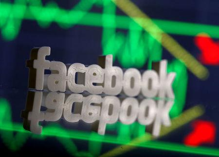 FILE PHOTO: A 3D-printed Facebook logo is seen in front of displayed stock graph in this illustration photo, March 20, 2018. REUTERS/Dado Ruvic/File Photo